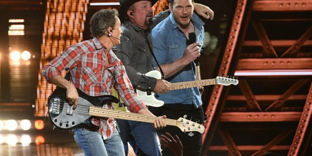 Garth Brooks and Chris Pratt perform on stage at the 2019 iHeartRadio Music Awards which broadcasted live on FOX from the Microsoft Theater in Los Angeles on Thursday.