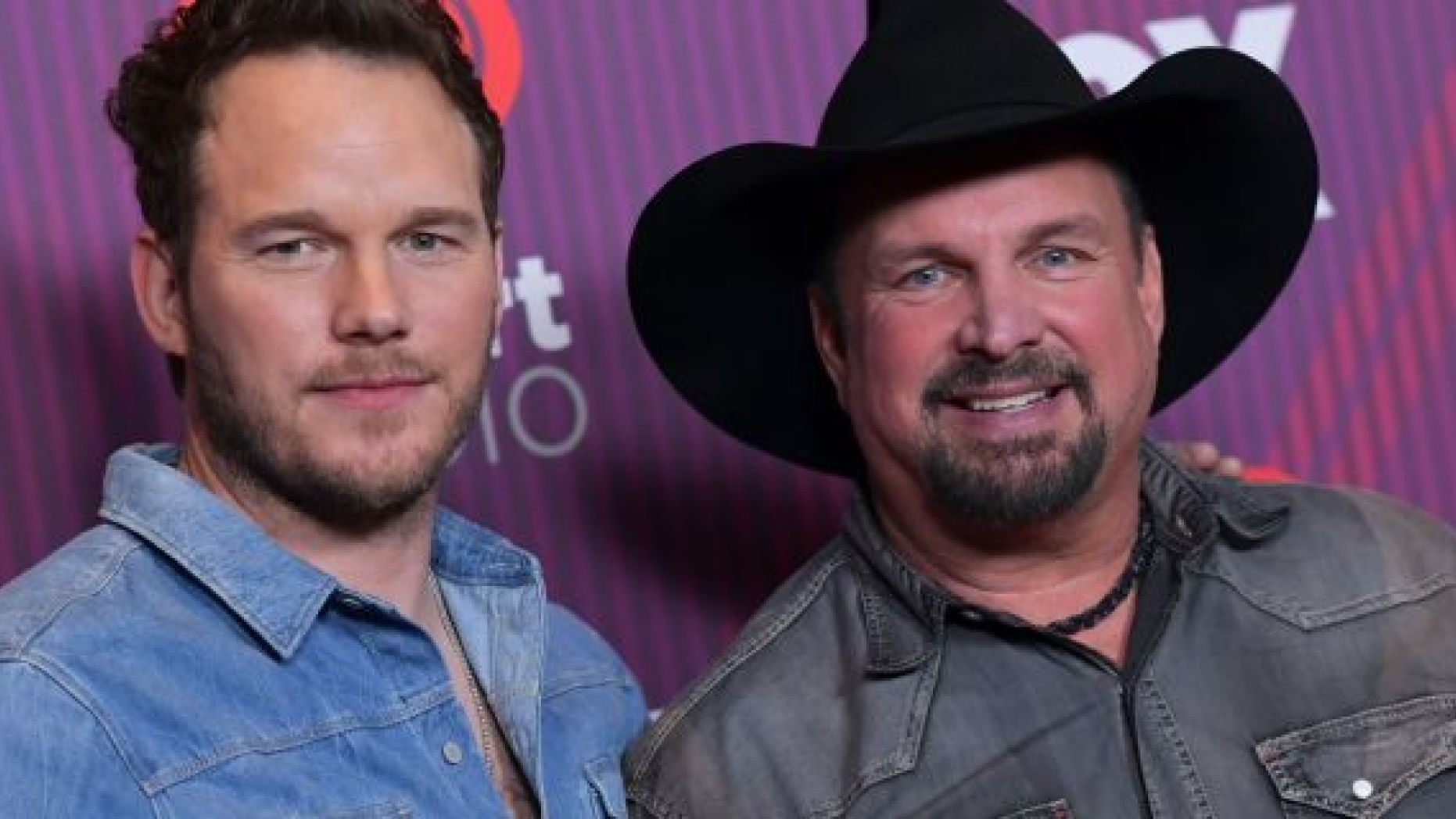 Garth Brooks and Chris Pratt pose in the press room during the 2019 iHeart Radio Music Awards in Los Angeles on Thursday.