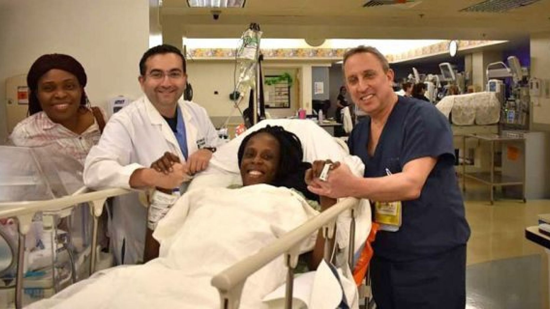 Thelma Chiaka with (l. to r.) relative Ebere Ofor; Dr. Ziad Haidar, perinatologist who delivered the babies; and Dr. Israel Simchowit, neonatologist also on staff at The Woman's Hospital of Texas.
