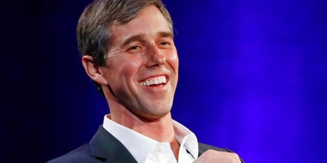 """Former Democratic Texas Congressman Beto O'Rourke laughs during a live interview with Oprah Winfrey on a Times Square stage at """"SuperSoul Conversations,"""" in New York, on Feb. 5, 2019. (AP Photo/Kathy Willens, File)"""