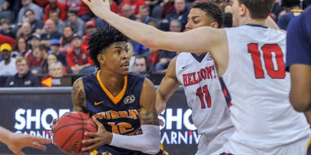 Murray State's Ja Morant (12) looks for an opening as Belmont's Kevin McClain (11) and Caleb Hollander (10) defend during the second half of an NCAA college basketball game for the championship of the Ohio Valley Conference men's tournament Saturday, March 9, 2019, in Evansville, Ind.