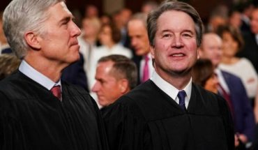 Supreme Court Associate Justices Neil Gorsuch, left, and Brett Kavanaugh watch as President Trump arrives to give his State of the Union address to a joint session of Congress at the Capitol in Washington. (Associated Press)