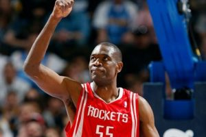 Houston Rockets center Dikembe Mutombo gestures while facing the Denver Nuggets in the first quarter of an NBA basketball game in Denver in 2008. (AP)