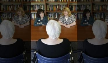 Carol Silver Elliott, left, CEO of Cedar Village retirement community, and caregiver Kim Bauer, right, talk with an elderly woman that has suffered abuse by a relative, at the facility in Mason, Ohio.