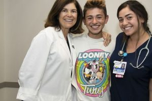 Michael Pruitt is pictured with Dr. Angel Chudler and nurse Yasmeen Bachir, who helped bring him back to life after he had no vital signs for 20 minutes.