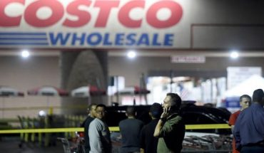 A Costco employee talks on the phone following a shooting within the wholesale outlet in Corona, Calif., Friday, June 14, 2019.