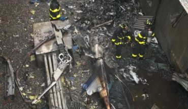 The aftermath of the helicopter crash Monday on top of a building in New York City.