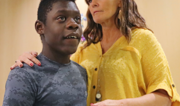 Jerri Hrubes stands next to her son DJ during a news conference Friday, June 7, 2019, in Salt Lake City. Hrubes is calling for an independent investigation after she says a police officer pointed a gun at her 10-year-old son