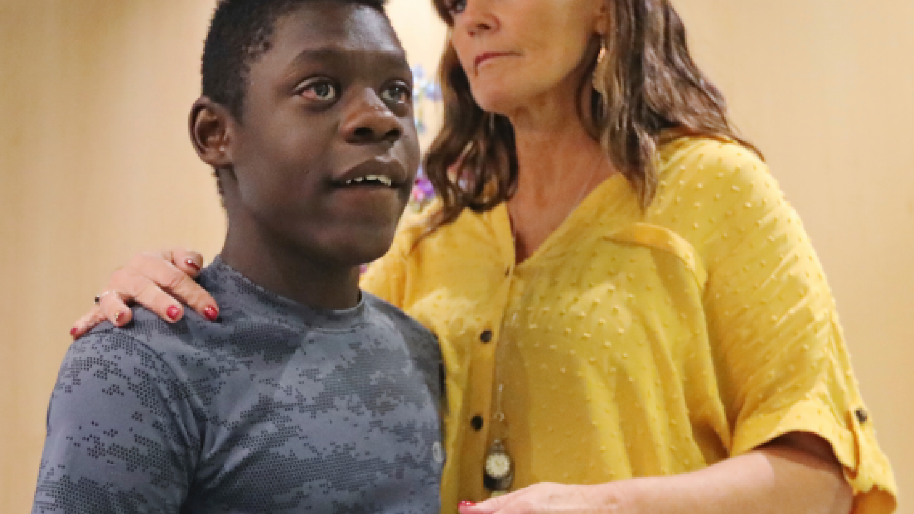 Jerri Hrubes stands next to her son DJ during a news conference Friday, June 7, 2019, in Salt Lake City <a class=