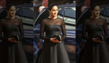 Meghan, Duchess of Sussex, poses for photographers upon arrival at the