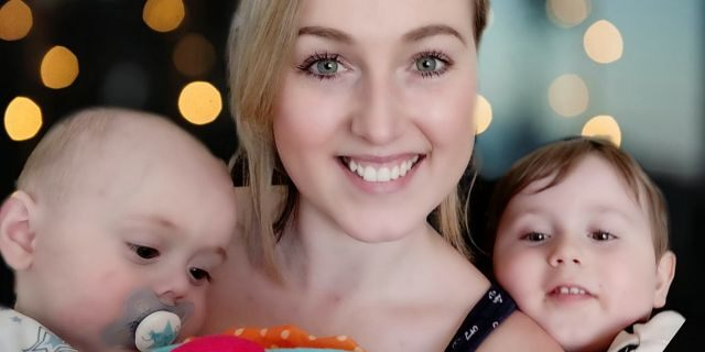 Boyle, pictured with her children, said she now worries about the possibility of a future diagnosis because of her reconstructive surgery.