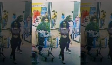 """Still from store video showing the suspected """"Blue Bell Licker"""" and her boyfriend. The girl, a juvenile whose name has not been released, has been identified by Lufkin, Texas, police as the person who licked a tub of ice cream in a Walmart store then put it back in the freezer. """