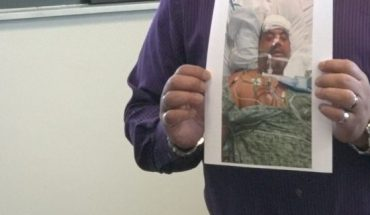 Martinez shows a picture of himself after the emergency surgery at the hospital, after his liposuction procedure