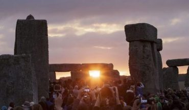 In this June 21, 2015, file photo, the sun rises as thousands of revelers gathered at the ancient stone circle Stonehenge to celebrate the Summer Solstice.