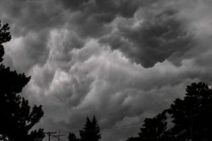 A storm bringing dark clouds, strong winds and a drop in temperature moves in over Flint, Mich., on Saturday, July 20, 2019.