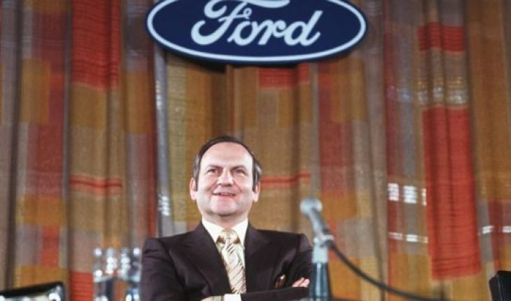 (Original Caption) Detroit, Michigan: Lee A. Iacocca, photographed under the Ford emblem at a news conference, was elected earlier as President of the Ford Motor Company by the board of directors. Iacocca joined the company 24 years ago. The announcement was made by Henry Ford II, board chairman.