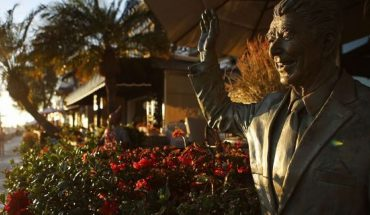 A statue of former President Ronald Reagan stands in front of a home on Orange County