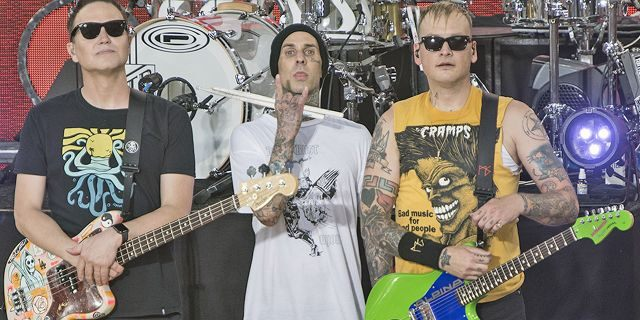 "Mark Hoppus, Travis Barker and Matt Skiba of Blink-182 perform on ABC's ""Good Morning America"" at Rumsey Playfield, Central Park on July 19, 2019 in New York City. The band dropped out of the disastrous Fyre Festival over technical concerns for their staging."