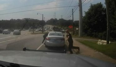 Georgia cop holds on two suspects vehicle as he's dragged onto freeway after traffic stop, video shows