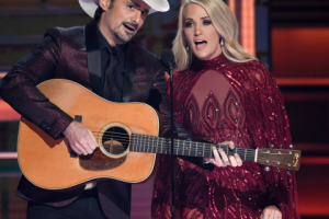 Hosts Brad Paisley, left, and Carrie Underwood during the opening of the 51st annual CMA Awards in Nashville, Tenn. Underwood will be working triple-duty at the 2018 Country Music Association Awards as co-host, performer and nominee. The singer, who is hosting the show alongside Brad Paisley for the 11th time, is pregnant and will hit the stage Wednesday night at the Bridgestone Arena in Nashville, Tennessee.