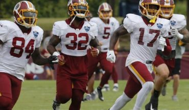 FILE - In this Aug. 5, 2019, file photo, Washington Redskins wide receiver Terry McLaurin (17) runs drills with teammates Samaje Perine (32) and Darlin Kidsy Jr., (84) during the Washington Redskins NFL football training camp in Richmond, Va. (AP Photo/Steve Helber, File)