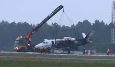 A private aircraft is recovered after it caught fire on landing at Aarhus Airport in Tirstrup, Denmark, Tuesday, Aug. 6, 2019.