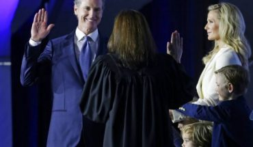 California Governor Gavin Newsom takes the oath of office from state Supreme Court Chief Justice Tani Gorre Cantil-Sakauye during his inauguration Monday, Jan. 7, 2019, in Sacramento, Calif. Looking on is Newsom