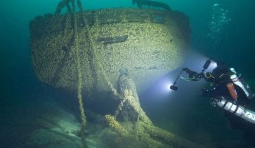 In this Aug. 24, 2019, photo provided by John Janzen, diver John Scoles maneuvers around the wreckage of the schooners Peshtigo and St. Andrews, lost in 1878 near Beaver Island in northern Lake Michigan. A group of maritime history enthusiasts led by Boyne City, Michigan diver and explorer, Bernie Hellstrom have announced the discovery of the schooners. The site was located in 2010 by Hellstrom during one of his many trips to explore the Beaver Island archipelago.