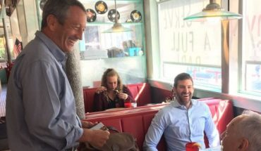 Former South Carolina governor and congressman Mark Sanford, making his first visit to New Hampshire since launching his bid for the 2020 GOP presidential nomination, greets voters at the Airport Diner in Manchester, on Sept. 19, 2019