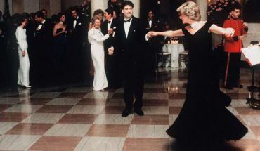 Princess Diana dances with actor John Travolta in a dress designed by Victor Edelstein, whilst attending a State Dinner at the White House in 1985.