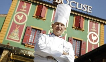 French chef Paul Bocuse, seen here in 2011, poses outside his famed Michelin L