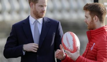 Prince Harry listens to Rugby League World Cup 2021 ambassador James Simpson in the gardens at Buckingham Palace in London, Thursday, Jan. 16.