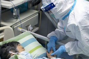 A medical worker attends to a patient in the intensive care unit at Zhongnan Hospital of Wuhan University in Wuhan in central China