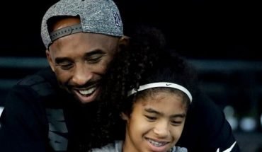 Los Angeles Laker Kobe Bryant and his daughter Gianna watch during the U.S. national championships swimming meet in Irvine, Calif. Bryant, the 18-time NBA All-Star who won five championships and became one of the greatest basketball players of his generation during a 20-year career with the Los Angeles Lakers, died in a helicopter crash Sunday, Jan. 26, 2020. Gianna also died in the crash. She was 13.