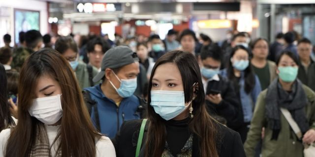 Passengers wear masks to prevent an outbreak of a new coronavirus in a subway station, in Hong Kong, Wednesday, Jan. 22, 2020. The first case of coronavirus in Macao was confirmed on Wednesday, according to state broadcaster CCTV. (AP Photo/Kin Cheung)