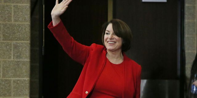Democratic presidential candidate Amy Klobuchar, D-Minn., waves as she arrives to speak to the Scott County Iowa Democrats Saturday, Jan <a class=