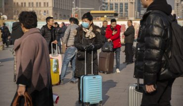 China counts sharp rise in coronavirus cases during country's busiest travel time, 2 in Beijing