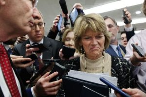 Sen. Lisa Murkowski, R-Alaska, center, and Sen. John Barrasso, R-Wyo., react to the final statement of House Democratic impeachment manager Rep. Adam Schiff, D-Calif., as they speak to the media at the end of a day of an impeachment trial of President Donald Trump on charges of abuse of power and obstruction of Congress, Friday, Jan. 24, 2020, on Capitol Hill in Washington. (Associated Press)