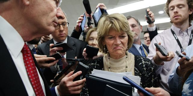 Sen. Lisa Murkowski, R-Alaska, center, and Sen. John Barrasso, R-Wyo., react to the final statement of House Democratic impeachment manager Rep. Adam Schiff, D-Calif., as they speak to the media at the end of a day of an impeachment trial of President Donald Trump on charges of abuse of power and obstruction of Congress, Friday, Jan <a class=