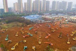 Heavy equipment at a construction site for a field hospital in Wuhan in central China