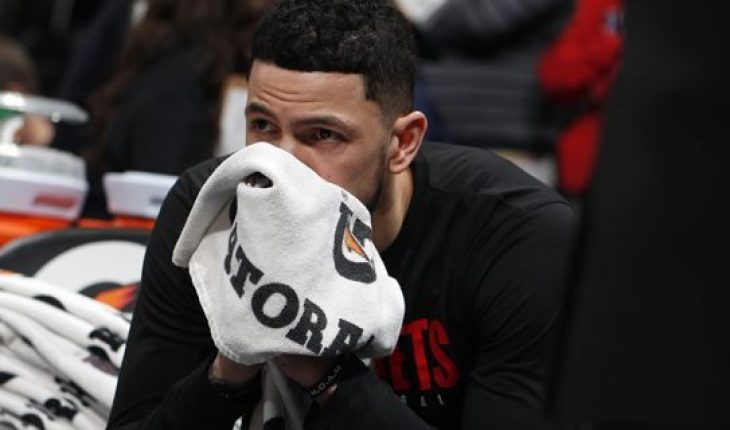 Houston Rockets guard Austin Rivers sits on the bench after word of the death of former NBA star Kobe Bryant before an NBA basketball game against the Denver Nuggets, Sunday, Jan. 26, 2020, in Denver. Bryant died in a California helicopter crash Sunday. (AP Photo/David Zalubowski)