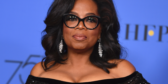 """FILE - In this Jan. 7, 2018 file photo, Oprah Winfrey poses in the press room with the Cecil B. DeMille Award at the 75th annual Golden Globe Awards in Beverly Hills, Calif. Winfrey will interview two men who say Michael Jackson sexually abused them as boys immediately after a documentary on the men. HBO and the Oprah Winfrey Network announced Wednesday that """"After Neverland,"""" will air on both channels Monday at 10 p.m. Eastern and Pacific. (Photo by Jordan Strauss/Invision/AP, File)"""
