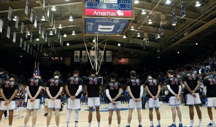 Duke players wear a Number 24 jersey during a moment of silence in memory of Kobe Bryant and his daughter Gianna Bryant prior to an NCAA college basketball game against Pittsburgh in Durham, N.C., Tuesday, Jan. 28, 2020. (AP Photo/Gerry Broome)