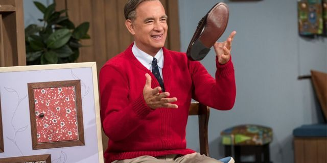 "Tom Hanks portrays Mister Rogers in ""A Beautiful Day in the Neighborhood."""
