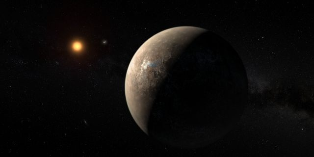 This artist's impression shows the planet Proxima b orbiting the red dwarf star Proxima Centauri, the closest star to the Solar System. The double star Alpha Centauri AB also appears in the image between the planet and Proxima itself.