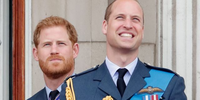 Prince Harry, left, and his older brother Prince William watch a flypast to mark the centenary of the Royal Air Force from the balcony of Buckingham Palace on July 10, 2018, in London, England.