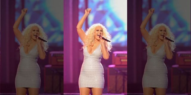 Christina Aguilera performs onstage at the 2011 American Music Awards <a class=
