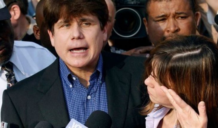 In this March 14, 2012, file photo, former Illinois Gov. Rod Blagojevich speaks to the media outside his home in Chicago as his wife, Patti, wipes away tears a day before reporting to prison after his conviction on corruption charges. (AP Photo/M. Spencer Green, File)