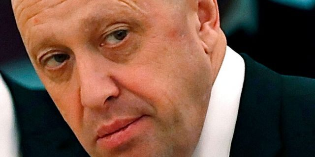 FILE - In this July 4, 2017 file photo, Russian businessman Yevgeny Prigozhin is shown prior to a meeting of Russian President Vladimir Putin and Chinese President Xi Jinping in the Kremlin in Moscow, Russia. The Justice Department is moving to drop charges against some Russian companies that were accused of funding a social media campaign to sway American public opinion during the 2016 U.S <a class=